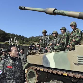 South Korean president Lee Myung-bak visits a marine base on Yeonpyeong Island near the Yellow Sea border with North Korea (AP)