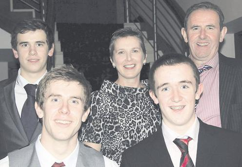 Kate Comiskey with her husband and sons