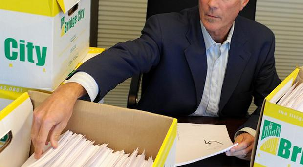 Lawyer Kelly Clark with some of the documents released by the Boy Scouts of America relating to sex abuse within the organisation (AP/Greg Wahl-Stephens)