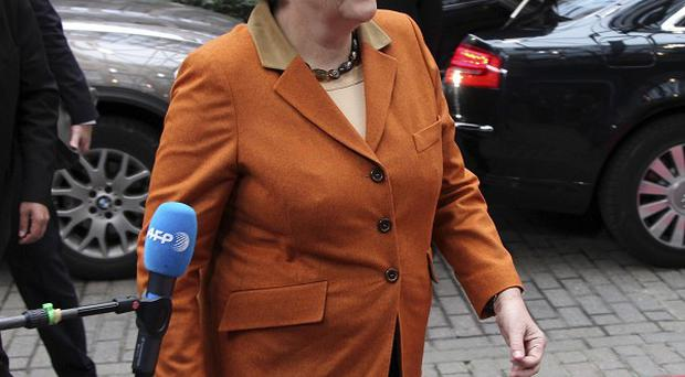 German Chancellor Angela Merkel is wary of using taxpayers' money to shore up European banks (AP/Yves Logghe)