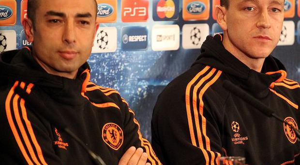 Roberto Di Matteo, left, refused to reveal if John Terry, right, is still Chelsea captain