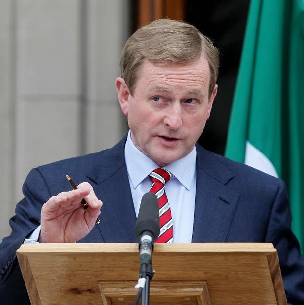 Enda Kenny, pictured, and Angela Merkel could clash as the former attempts to cut a deal on Ireland's 64 billion euro bank bailout