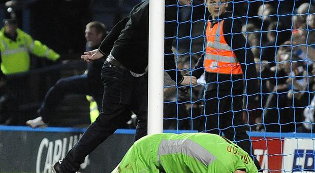 Sheffield Wednesday goalkeeper Chris Kirkland on the ground after being struck by a Leeds United fan