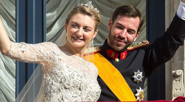 Luxembourg's Prince Guillaume and Countess Stephanie wave from the balcony of the Royal Palace (AP)