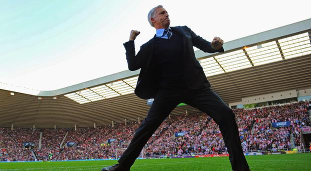 SUNDERLAND, ENGLAND - OCTOBER 21: Newcastle manager Alan Pardew celebrates after his team's goal during the Barclays Premier League match between Sunderland and Newcastle United at the Stadium of Light on October 21, 2012 in Sunderland, England. (Photo by Michael Regan/Getty Images) *** BESTPIX ***