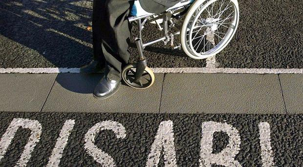 Questions have been raised over why a fifth of people in West Belfast are still drawing Disability Living Allowance