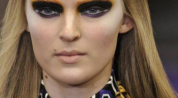 Stripes and geometries decorated eyelids at Prada