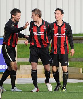Paul Heatley (right) is congratulated on sinking the Mallards by team mates Craig McClean and Matthew Snoddy