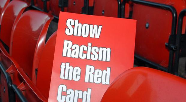 Show Racism the Red Card have backed players who refused to wear Kick It Out t-shirts