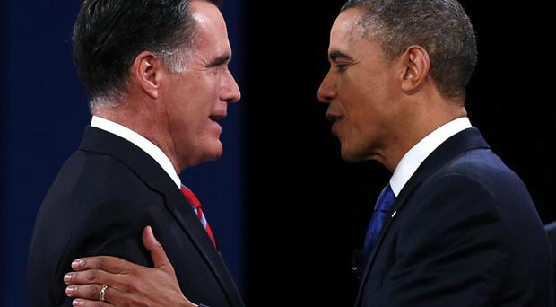 BOCA RATON, FL - OCTOBER 22: U.S. President Barack Obama (R) greets Republican presidential candidate Mitt Romney (L) at the start of a debate at the Keith C. and Elaine Johnson Wold Performing Arts Center at Lynn University on October 22, 2012 in Boca Raton, Florida. The focus for the final presidential debate before Election Day on November 6 is foreign policy. (Photo by Justin Sullivan/Getty Images)