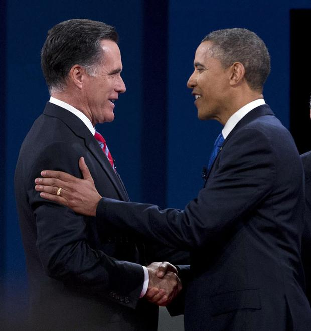 Mitt Romney shakes hands with President Barack Obama before the start of the third debate