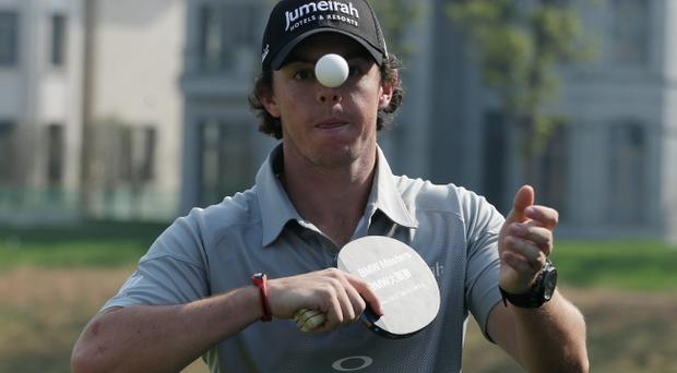 SHANGHAI, CHINA - OCTOBER 23: Rory McIlroy of Northern Ireland plays table tennis during the photocall and press conference prior to the start of the BMW Masters at the Lake Malaren Golf Club on October 23, 2012 in Shanghai, China. (Photo by Scott Halleran/Getty Images)