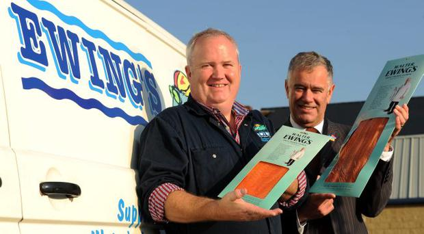 Crawford Ewing (left), director Ewing's Seafoods in Belfast, shows Maynard Mawhinney, Invest NI's director of food and tourism, the new smoked salmon that's proving popular in Dubai
