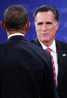 President Barack Obama shakes hands with Republican presidential candidate Mitt Romney after the debate at the Keith C. and Elaine Johnson Wold Performing Arts Center at Lynn University on October 22, 2012 in Boca Raton, Florida.
