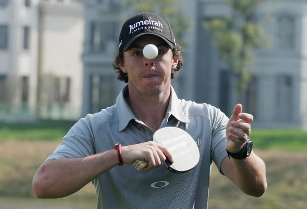 Rory McIlroy plays table tennis during the photocall and press conference prior to the start of the BMW Masters at the Lake Malaren Golf Club on October 23, 2012 in Shanghai, China