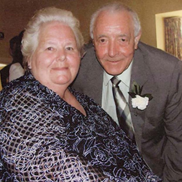 Bertie Acheson, pictured with his wife Sheila, died of a heart attack after struggling with a burglar demanding money in April (PSNI/PA)