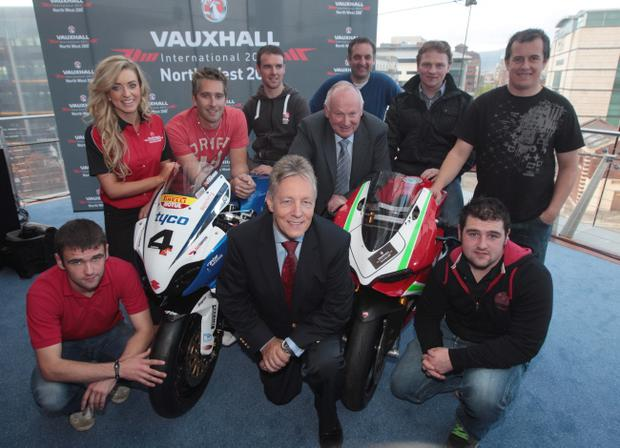 First Minister Peter Robinson pictured along with Mervyn Whyte MBE, Ms NW200 Kathryn Munis and riders WIlliam Dunlop, David Johnston, Alastair Seeley, Michael Rutter, Stephen Thompson, John McGuinness and Michael Dunlop at the launch of the 2013 Vauxhall International North West 200 motorbike races