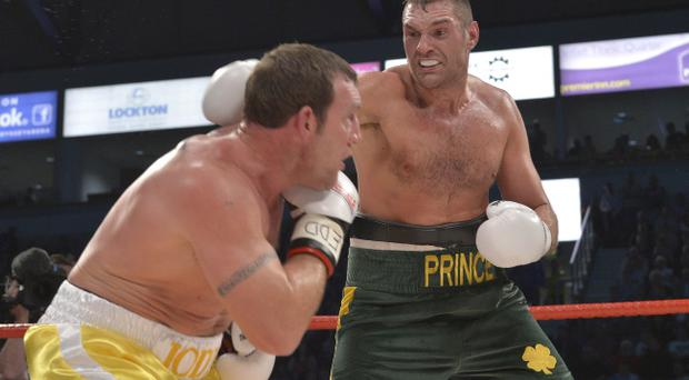 Tyson Fury, seen on his way to stopping Martin Rogan, wants a world title fight at Croke Park next year