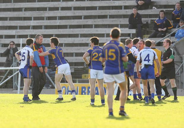 Ronan McGuckin, confronted by Michael Brady (left), has requested a break as Errigal Ciaran boss