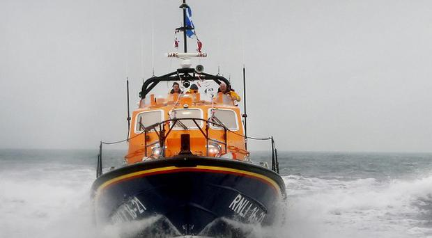 An RNLI lifeboat helped two men who had fallen into the sea off the County Down coast