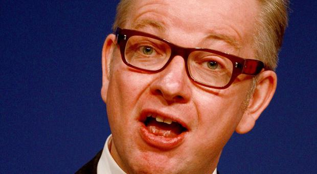 Education Secretary Michael Gove has issued an apology to his former French teacher