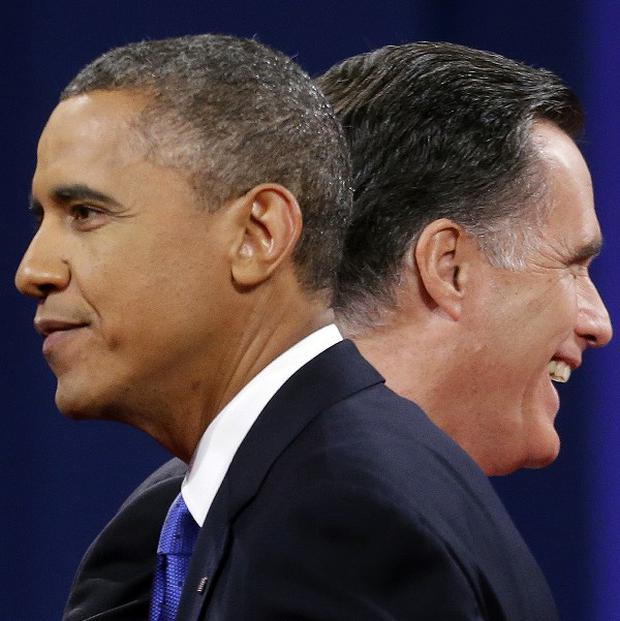 Barack Obama and Mitt Romney walk past each other at the end of the final debate at Lynn University in Florida (AP)