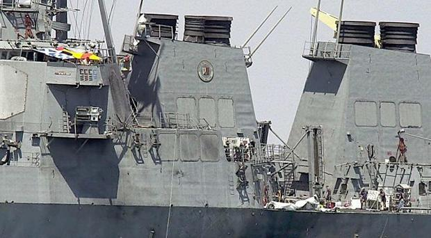 The hull of the USS Cole at the Yemeni port of Aden, after an explosion ripped a hole in the US Navy destroyer (AP/Dimitri Messinis)