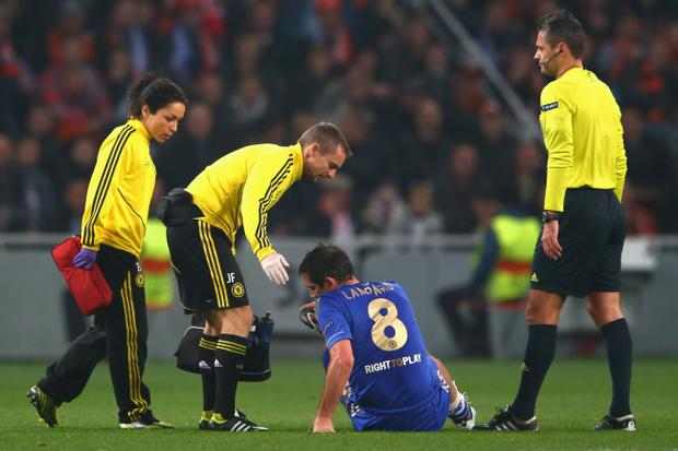 DONETSK, UKRAINE - OCTOBER 23: Frank Lampard of Chelsea goes down injured and is substituted during the UEFA Champions League Group E match between Shakhtar Donetsk and Chelsea at the Donbass Arena on October 23, 2012 in Donetsk, Ukraine. (Photo by Michael Steele/Getty Images)