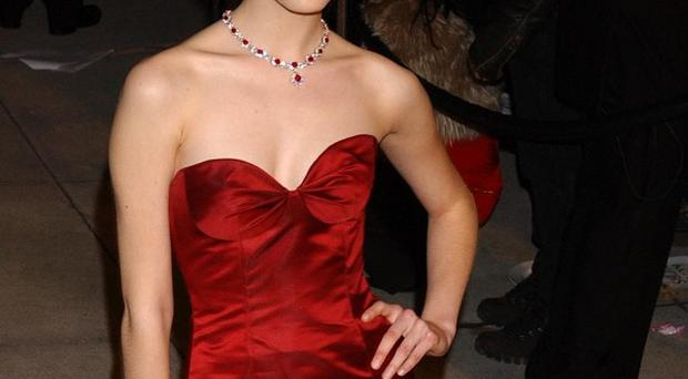 Emmy Rossum is apparently set to star opposite Hilary Swank