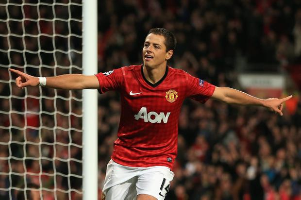 MANCHESTER, ENGLAND - OCTOBER 23: Javier Hernandez of Manchester United celebrates scoring his team's third goal to make the score 3-2 during the UEFA Champions League Group H match between Manchester United and SC Braga at Old Trafford on October 23, 2012 in Manchester, England. (Photo by Richard Heathcote/Getty Images)