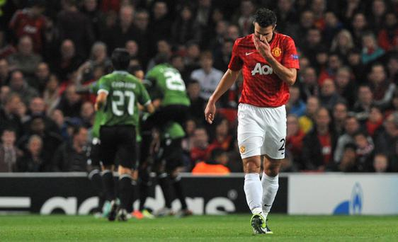 Manchester United's Robin Van Persie shows his dejection after Braga's second goal during the UEFA Champions League match at Old Trafford