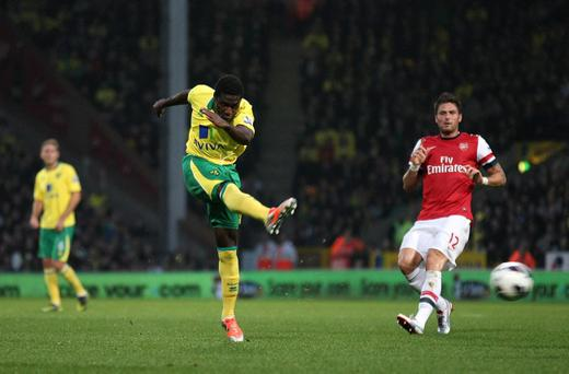 Norwich City's Alexander Tettey has a shot on goal which teammate Grant Holt followed up to score against Arsenal during the Barclays Premier League match at Carrow Road on Saturday. Norwich won the game 1-0