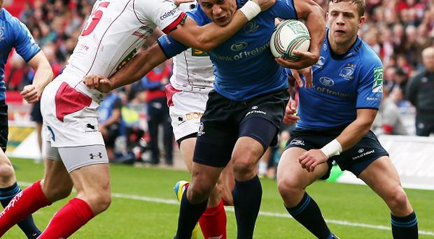 Isa Nacewa, centre, scored a try as Leinster defeated the Scarlets in the Heineken Cup
