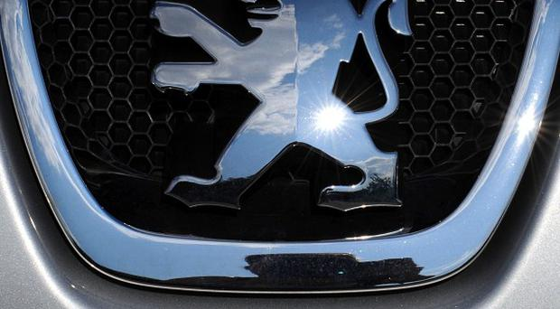 French car maker PSA Peugeot Citroen is closing one factory this year and plans to lay off thousands of workers