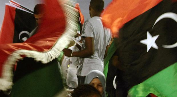 Libyans celebrate the first anniversary of the country's liberation from Gaddafi (AP)