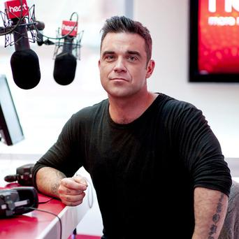 Robbie Williams is dad to new daughter Teddy