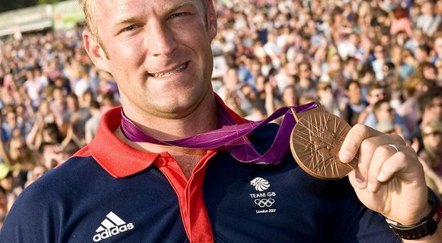 Rower Alex Partridge shows off his bronze Olympic medal