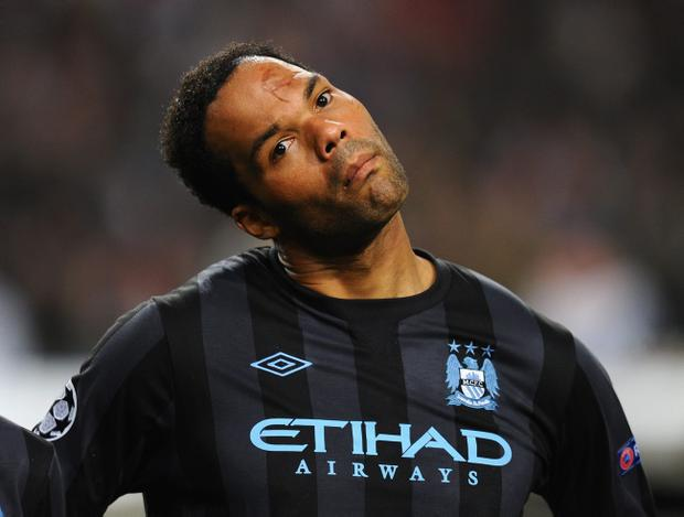 AMSTERDAM, NETHERLANDS - OCTOBER 24: Joleon Lescott of Manchester City looks on during the UEFA Champions League Group D match between AFC Ajax v Manchester City at the Amsterdam Arena on October 24, 2012 in Amsterdam, Netherlands. (Photo by Mike Hewitt/Getty Images)