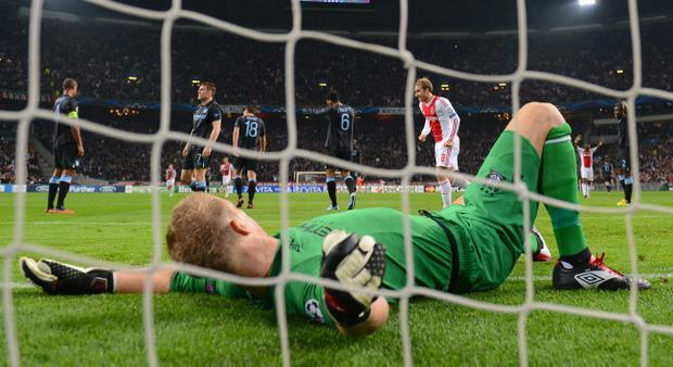 AMSTERDAM, NETHERLANDS - OCTOBER 24: Goalkeeper Joe Hart of Manchester City is down and out following a goal from Siem de Jong of Ajax during the UEFA Champions League Group D match between AFC Ajax v Manchester City at the Amsterdam Arena on October 24, 2012 in Amsterdam, Netherlands. (Photo by Mike Hewitt/Getty Images)