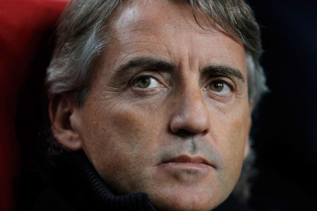 AMSTERDAM, NETHERLANDS - OCTOBER 24: Manchester City Manager, Roberto Mancini looks on during the Group D UEFA Champions League match between AFC Ajax and Manchester City FC at Amsterdam ArenA on October 24, 2012 in Amsterdam, Netherlands. (Photo by Dean Mouhtaropoulos/Getty Images)