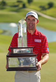 SOUTHAMPTON, BERMUDA - OCTOBER 24: Padraig Harrington of Ireland poses with the trophy after winning the PGA Grand Slam of Golf at Port Royal Golf Course on October 24, 2012 in Southampton, Bermuda. (Photo by Mike Ehrmann/Getty Images)