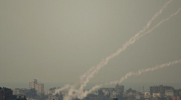 Smoke trails of rocket fired by Palestinian militants from Gaza Strip towards Israel (AP/Ariel Schalit)