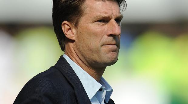 Swansea manager Michael Laudrup is expecting a tough test against Manchester City
