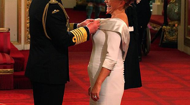 Actress Amanda Redman is awarded an MBE by the Prince of Wales, during an investiture ceremony at Buckingham Palace, London
