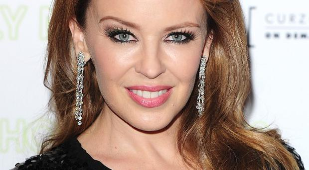 Kylie Minogue dazzled the Prince of Wales and the Duchess of Cornwall when she performed a surprise concert