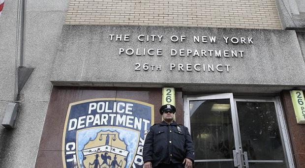 A police officer stands guard outside the 26th precinct where Gilberto Valle worked in New York (AP)