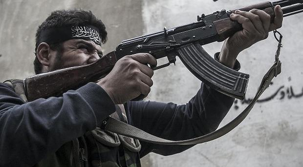 The Syrian army has announced a ceasefire in its operations against rebels like this Free Syrian Army fighter (AP)