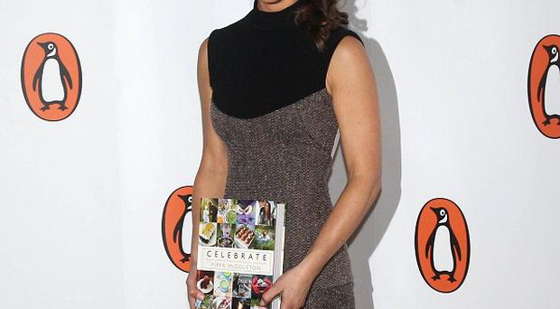 Pippa Middleton arrives for the launch of her party planning book, Celebrate