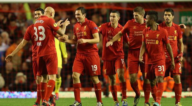 LIVERPOOL, ENGLAND - OCTOBER 25: Stewart Downing of Liverpool celebrates scoring the opening goal with his team-mates during the UEFA Europa League Group A match between Liverpool FC and FC Anzhi Makhachkala at Anfield on October 25, 2012 in Liverpool, England. (Photo by Clive Brunskill/Getty Images)