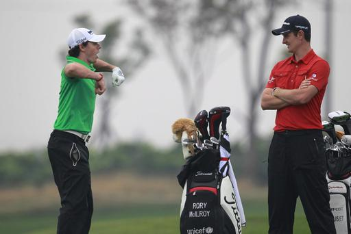 Rory McIlroy, left, and Justin Rose chat before teeing off on the 4th tee during the first round of the Masters golf tournament in Shanghai, China on Thursday Oct. 25, 2012. (AP Photo)